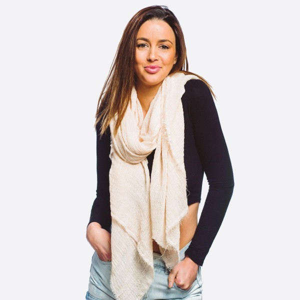 """Women's lightweight solid color scarf with fringe edges.  - Approximately 37"""" W x 72"""" L - 50% Cotton, 50% Polyester"""