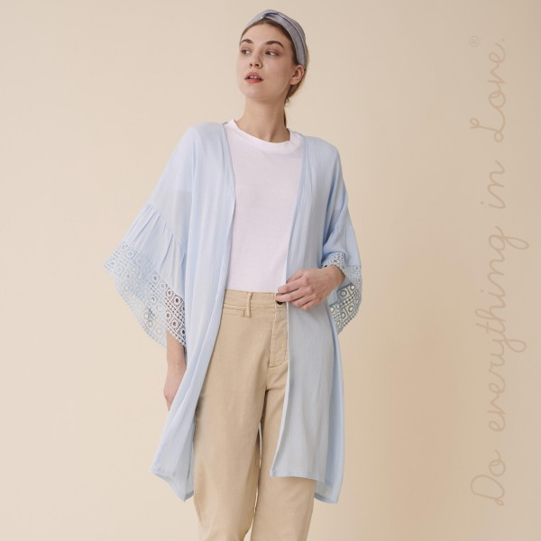"""Do everything in Love brand women's lightweight crochet ruffle sleeve kimono.  - One size fits most 0-14 - Approximately 34"""" L - 100% Viscose"""