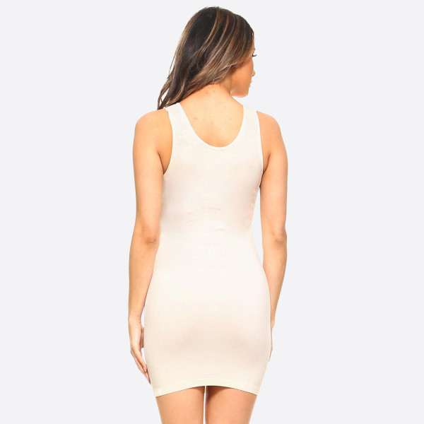 The traditional ribbed tank dress is in for the long haul with memory fibers that hugs those curves like an hour glass. Extended hemline ends above the knee in the classic mini styling boy dress. 