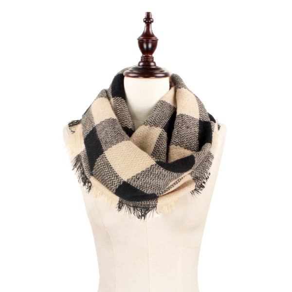 "Black and tan, heavyweight buffalo plaid infinity scarf with fringe. 100% acrylic.  Measures 18"" x 36"" in size."