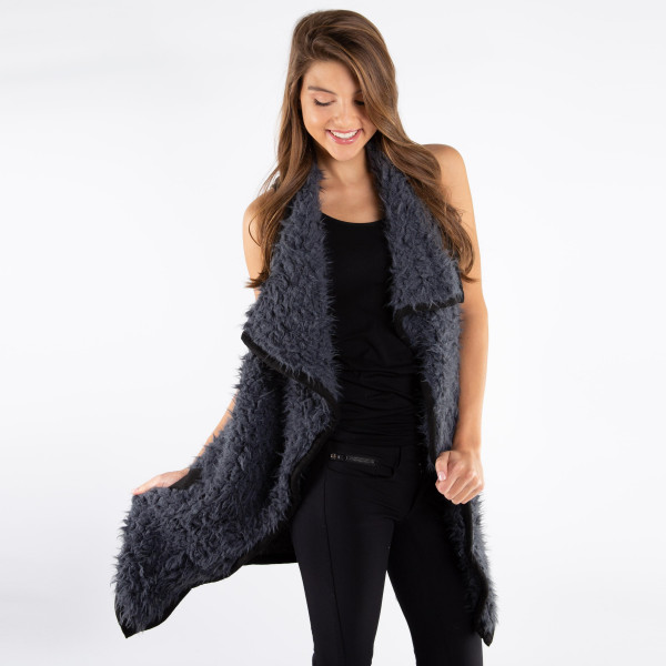 Charcoal gray, faux fur vest with a black trim and faux front pockets. 100% polyester. One size fits most.