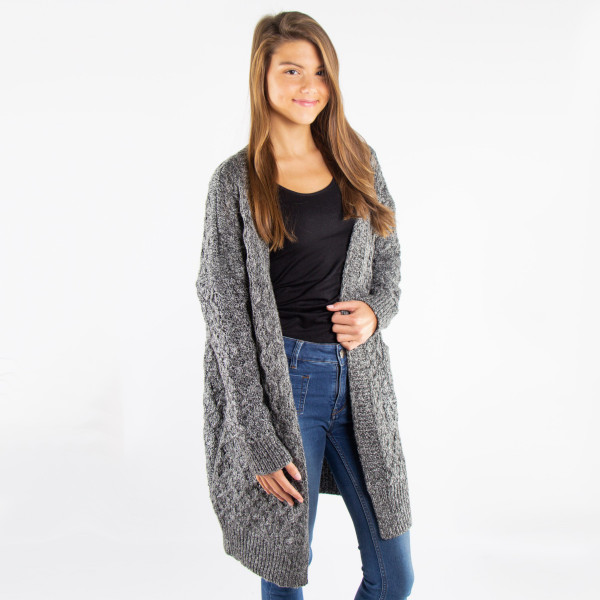 Black and white knit cardigan with an open front and two pockets. 100% acrylic. One size fits most.
