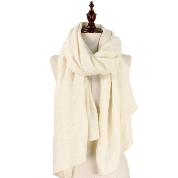"Solid ivory, open scarf with a cable knit pattern. 100% acrylic. Measures 31"" x 72"" in size."