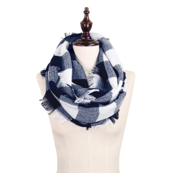"Navy blue and white, heavyweight buffalo plaid infinity scarf with fringe. 100% acrylic. Measures 18"" x 36"" in size."