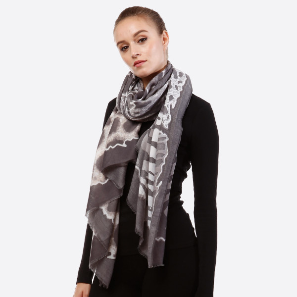 """Charcoal and taupe open scarf with animal prints and frayed edges. 100% viscose. Measures 36"""" x 72"""" in size."""