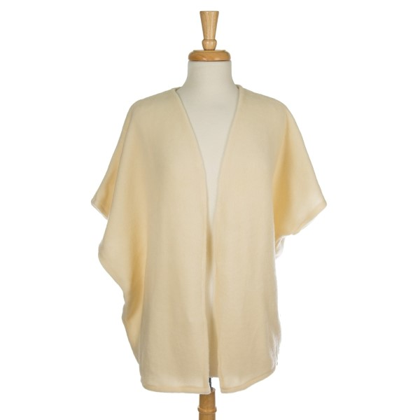 Soft, knit kimono with a bow back and short sleeves. 68% acrylic, 15% polyester, and 17% spandex. One size fits most.