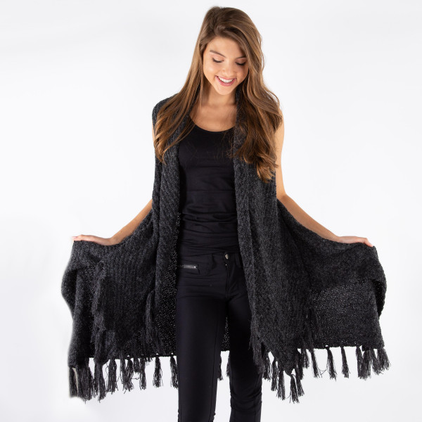 Black knit vest with a tapered front and fringe along the bottom hem. 100% acrylic. One size fits most.