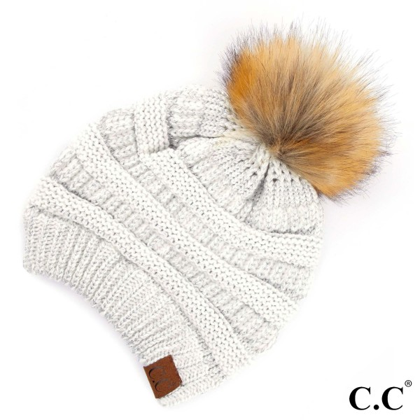 Metallic thread, cable knit, original C.C beanie with a faux fur pom pom, in ivory/silver. 100% acrylic.