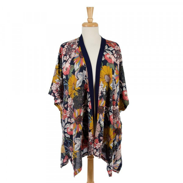 Short sleeve, lightweight kimono with a tropical floral print. 100% viscose. One size fits most.
