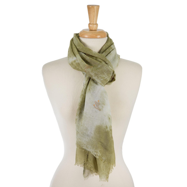 "Lightweight solid scarf with a gold glitter, cactus print. 100% polyester. Measures 27"" x 70"" in size."