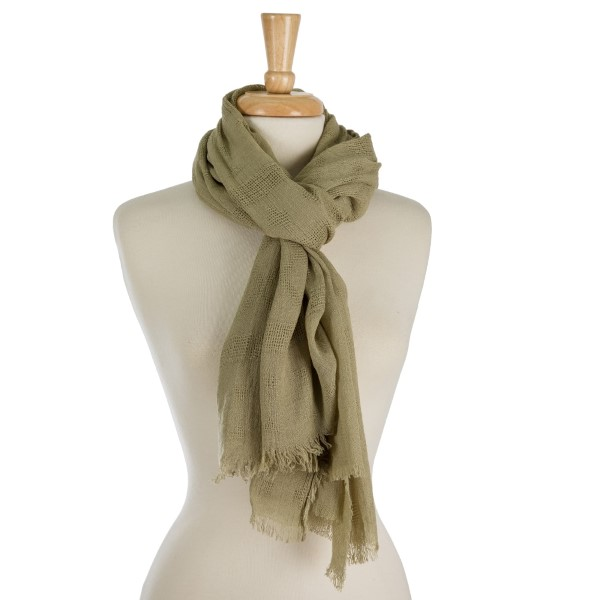 "Lightweight, open scarf with frayed edges. 100% viscose. Measures 31"" x 70"" in size."