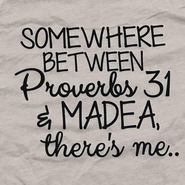 SOMEWHERE BETWEEN PROVERBS 31 AND MADEA, THERE'S ME - Short Sleeve Boutique Graphic Tee. These t-shirts are sold in a 6 pack. S:1 M:2 L:2 XL:1 52% Cotton and 48% Polyester Brand: Bella Canvas