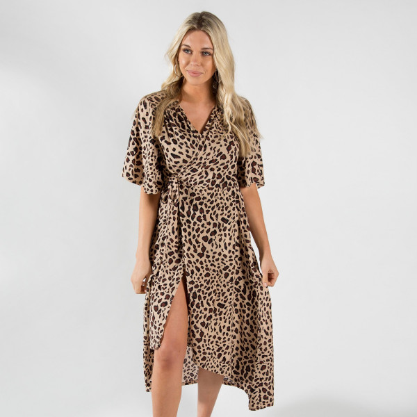 Long, duster length leopard kimono with a tie front. 100% viscose. One size fits most.
