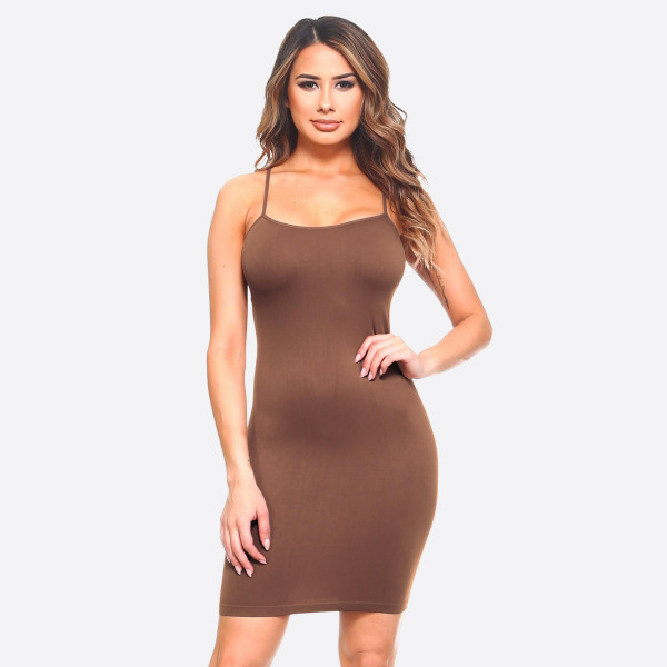 This is your seamless solid color casual go-to comfortable dress/top with Spaghetti Straps. This is a great dress/top for layering or simply just worn plain with accessories.   - Long Cami Top  - Round Neckline  - Spaghetti Straps  - Body Contouring - Figure Hugging - Solid Color  - Comfortable  - Super Soft  - Stretchy   One Size Fits Most 0-14.  Composition: 92% Nylon, 8% Spandex