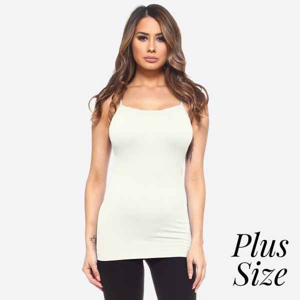 This seamless tank top features spaghetti straps, fade-resistant fabric, soft, and stretchy material. It's great for layering or wearing alone on a hot day.   -Scoop-neck  -Super Soft  -Stretchy  -Machine Wash  -Imported   - One size fits most 16-22  - Content: 92% Nylon, 8% Spandex