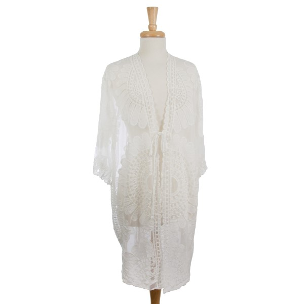 Lightweight, short sleeve, duster length kimono. 50% cotton 50% polyester. One size fits most.