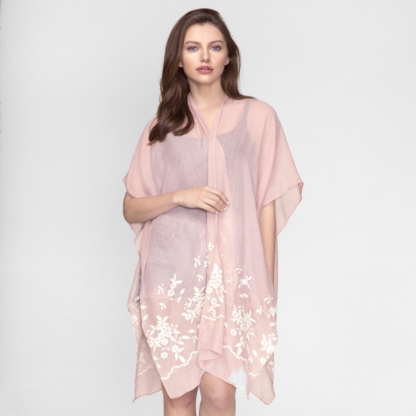 Lightweight, short sleeve kimono with an embroidered flowers. 100% viscose. One size fits most.