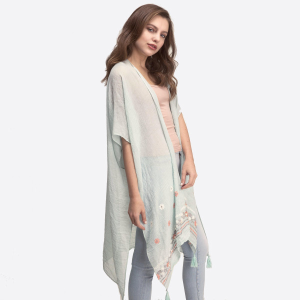 Lightweight, short sleeve kimono with floral embroidery and pearl accent. 35% viscose and 65% polyester. One size fits most.