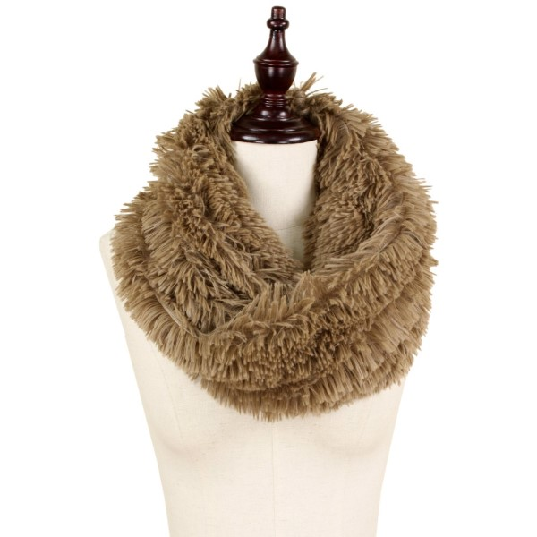 "Faux fur twisted tube scarf. 100% polyester. Size: 16""W x 11.5""L"
