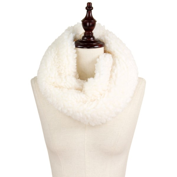 "Fluffy faux fur tube scarf. 100% polyester. Approximately 11""x15"""