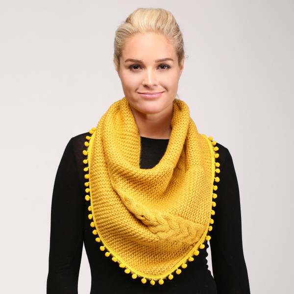 Cable knit infinity scarf with pom pom trim. 100% acrylic.