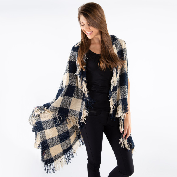 Soft touch buffalo check vest. 100% acrylic.   One size fits most.
