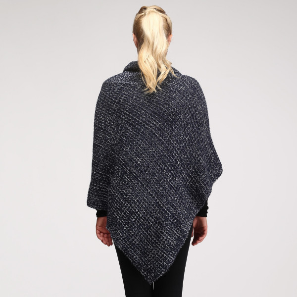 Knit poncho with button detail. 100% acrylic.   One size fits most.