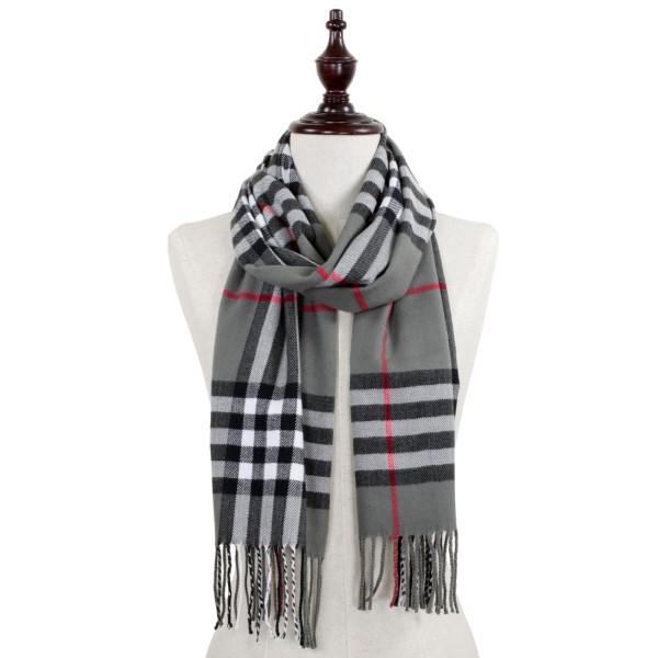 Plaid oblong scarf with fringe. 100% acrylic.