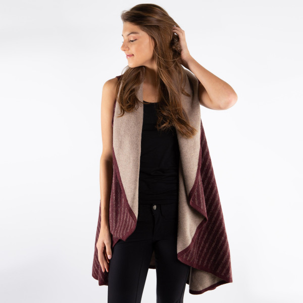 Heavyweight vest with cape detail and stripe accent. 100% acrylic.