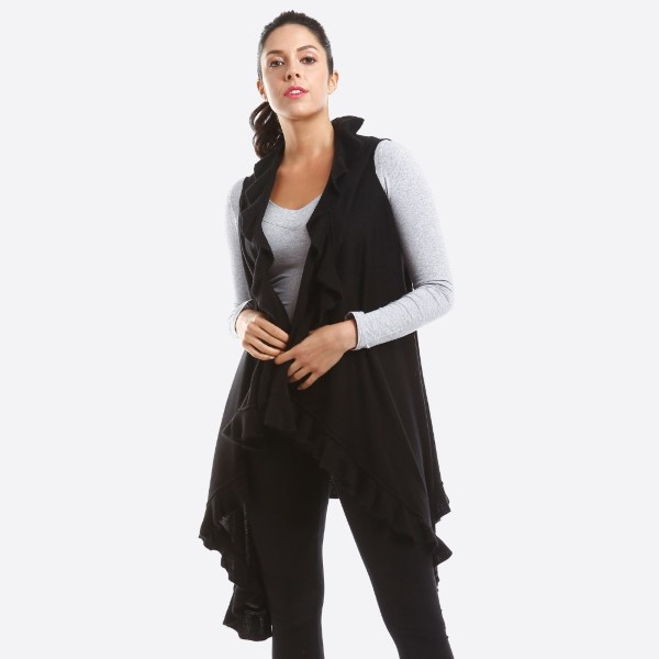 Soft knit vest with ruffle trim. 100% acrylic.   One size fits most.