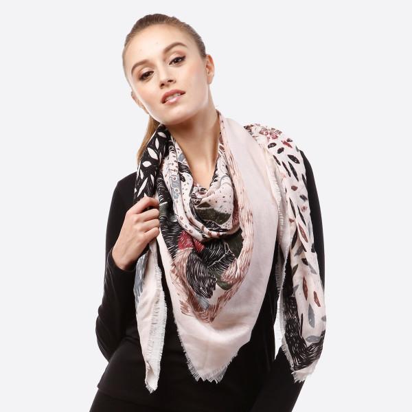 Lightweight printed scarf. 100% acrylic.