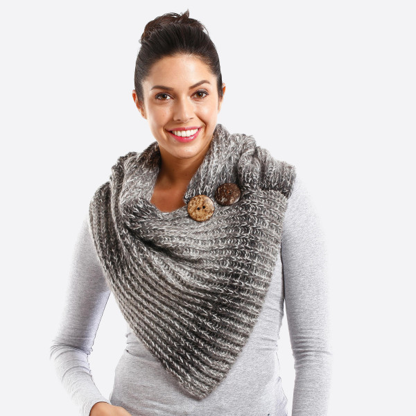 Knit scarf with button detail. 100% acrylic.