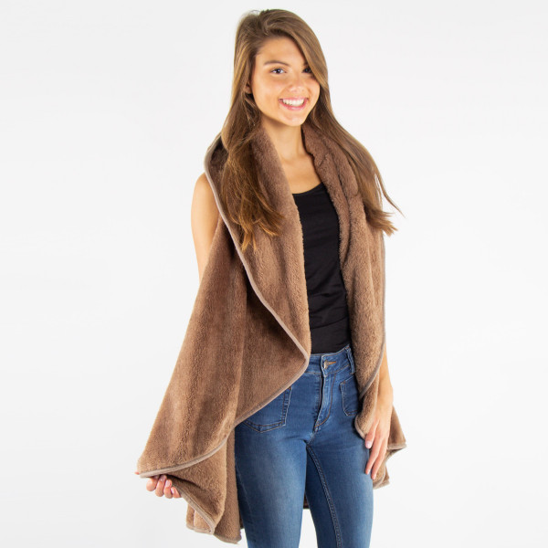 Faux fur shawl vest. 100% polyester. One size fits most.