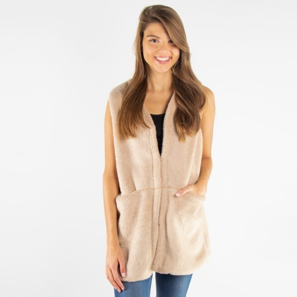 Luxe faux fur pocket vest.   - One size fits most 0-14 - 100% Polyester