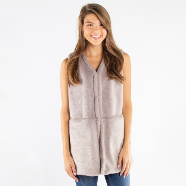 Luxe faux fur pocket vest. 100% polyester. One size fits most.