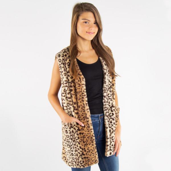 Leopard faux fur vest with pocket details.   - One size fits most 0-14 - 100% Acrylic