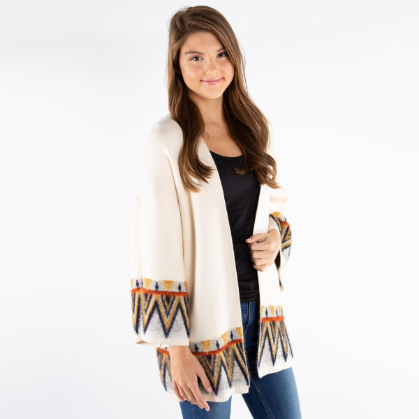 Soft cardigan with aztec border. 50% Viscose, 28% Nylon, and 22% polyester.   One size fits most.