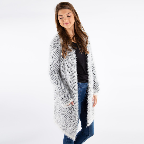 Soft knit mohair cardigan. 100% polyester.   One size fits most.