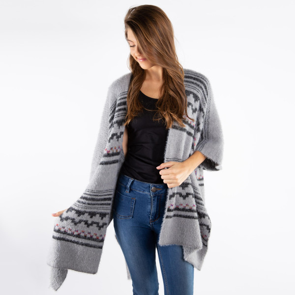 Soft touch mohair aztec shawl. 100% acrylic.   One size fits most.