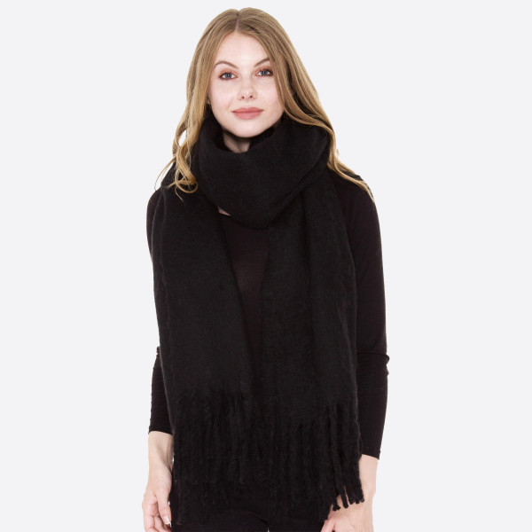 Soft oblong scarf with fringes.  - 100% Acrylic