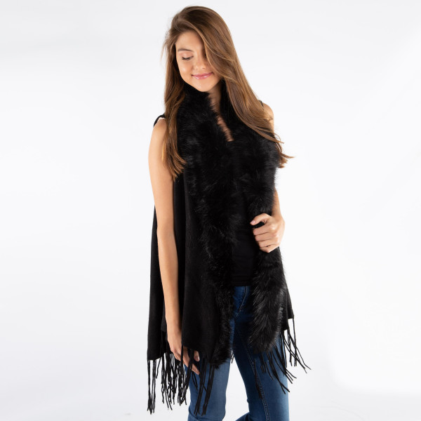 Solid color vest with fringe and faux fur trim. 100% acrylic.   One size fits most.