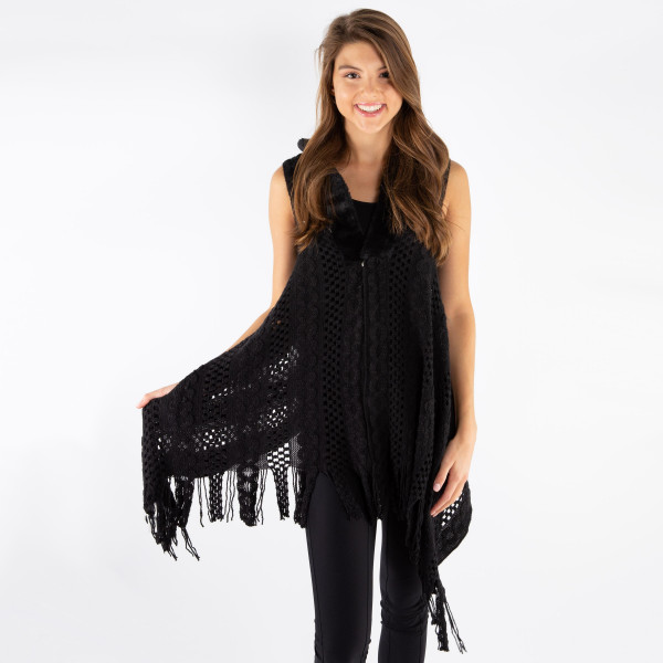 Knit vest with faux fur color and fringe. 100% acrylic.   One size fits most.