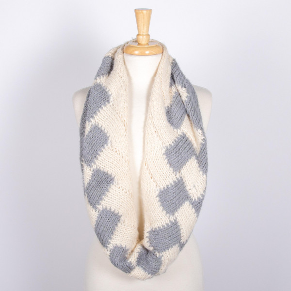 Two tone cable knit infinity scarf. 100% acrylic.