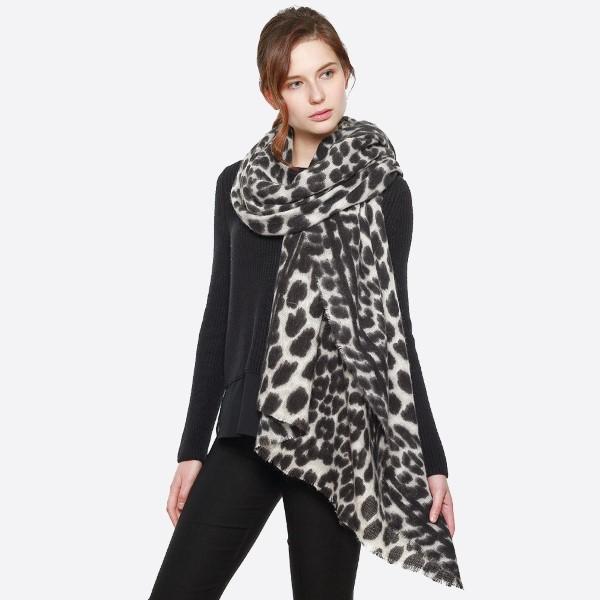Leopard print lightweight scarf. 100% acrylic.