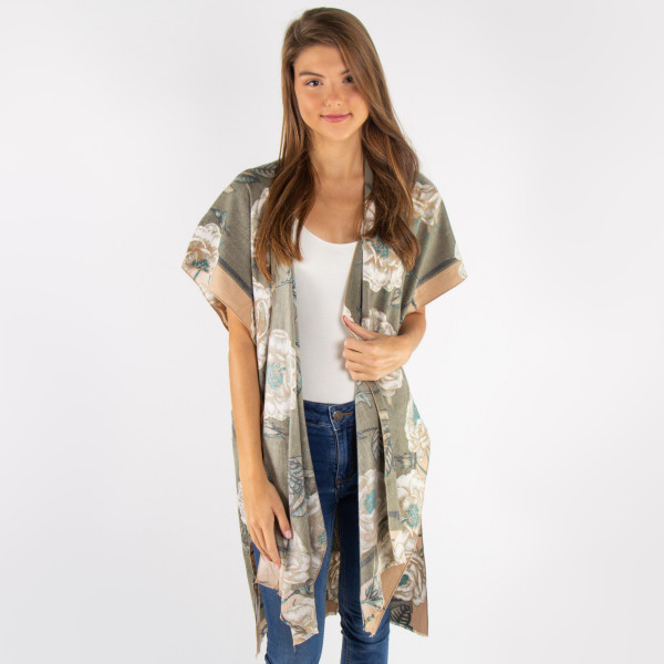 Floral print lightweight kimono. 70% cotton and 30% acrylic.   One size fits most.