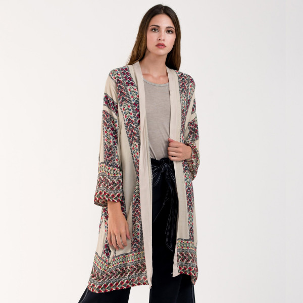 Embroidered faux suede cape shawl. 100% polyester.