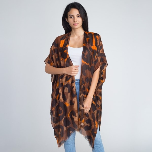 Leopard print kimono. 100% polyester.   One size fits most.