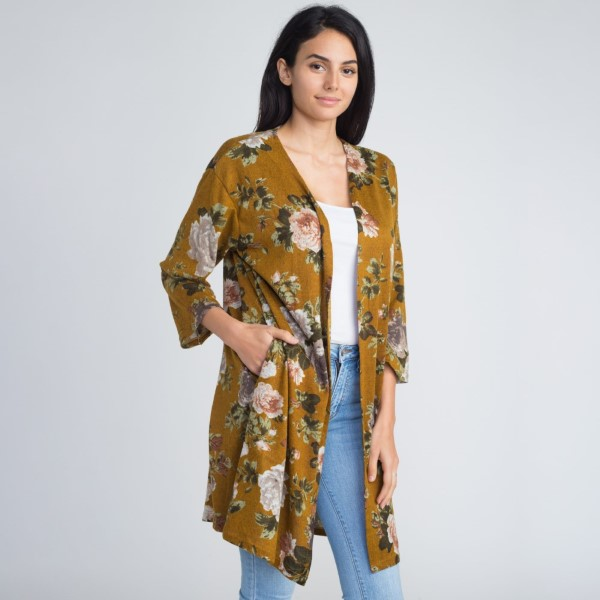 Floral print kimono with pockets. 100% polyester.   One size fits most.