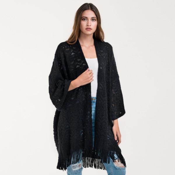 Crochet knit cardigan with fringe. 100% acrylic.
