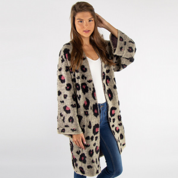 Heavy weight mohair leopard print cardigan. 60% polyamide, 20% acrylic, and 20% polyester. One size fits most.